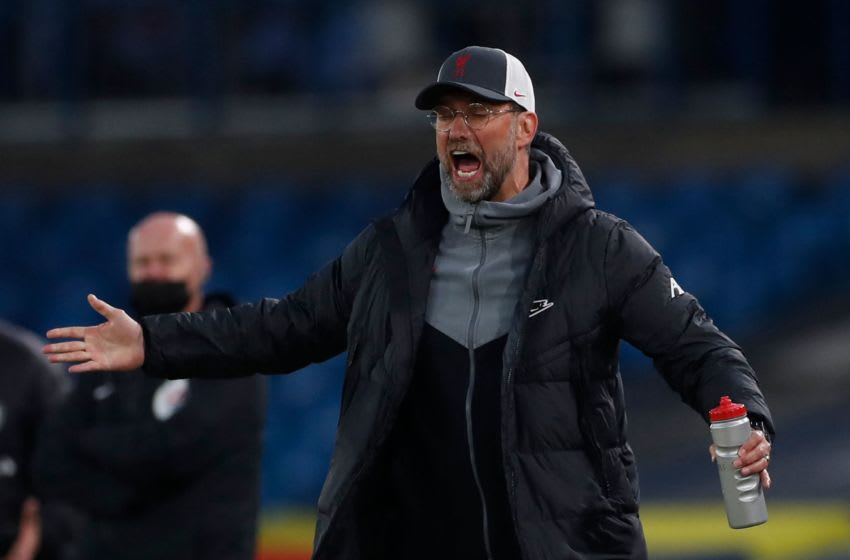 Liverpool's German manager Jurgen Klopp gestures from the touchline during the English Premier League football match between Leeds United and Liverpool at Elland Road in Leeds, northern England on April 19, 2021. - RESTRICTED TO EDITORIAL USE. No use with unauthorized audio, video, data, fixture lists, club/league logos or 'live' services. Online in-match use limited to 120 images. An additional 40 images may be used in extra time. No video emulation. Social media in-match use limited to 120 images. An additional 40 images may be used in extra time. No use in betting publications, games or single club/league/player publications. (Photo by LEE SMITH / POOL / AFP) / RESTRICTED TO EDITORIAL USE. No use with unauthorized audio, video, data, fixture lists, club/league logos or 'live' services. Online in-match use limited to 120 images. An additional 40 images may be used in extra time. No video emulation. Social media in-match use limited to 120 images. An additional 40 images may be used in extra time. No use in betting publications, games or single club/league/player publications. / RESTRICTED TO EDITORIAL USE. No use with unauthorized audio, video, data, fixture lists, club/league logos or 'live' services. Online in-match use limited to 120 images. An additional 40 images may be used in extra time. No video emulation. Social media in-match use limited to 120 images. An additional 40 images may be used in extra time. No use in betting publications, games or single club/league/player publications. (Photo by LEE SMITH/POOL/AFP via Getty Images)