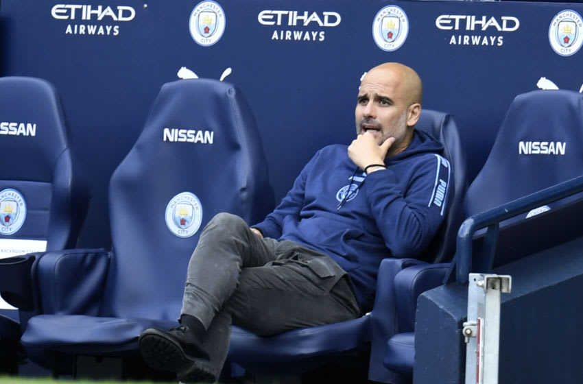 MANCHESTER, ENGLAND - JULY 26: Pep Guardiola, Manager of Manchester City looks on from the touchline during the Premier League match between Manchester City and Norwich City at Etihad Stadium on July 26, 2020 in Manchester, England.Football Stadiums around Europe remain empty due to the Coronavirus Pandemic as Government social distancing laws prohibit fans inside venues resulting in all fixtures being played behind closed doors. (Photo by Peter Powell/Pool via Getty Images)