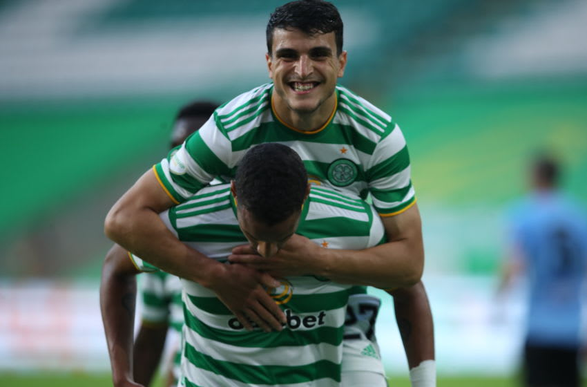 GLASGOW, SCOTLAND - AUGUST 18: Christopher Jullien of Celtic celebrates with Mohamed Elyounoussi after scoring his team's third goal during the UEFA Champions League: First Qualifying Round match between Celtic and KR Reykjavik at Celtic Park on August 18, 2020 in Glasgow, Scotland. (Photo by Ian MacNicol/Getty Images)