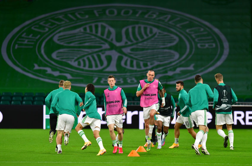 GLASGOW, SCOTLAND - OCTOBER 22: The Celtic side warm up prior to kick off during the UEFA Europa League Group H stage match between Celtic and AC Milan at Celtic Park on October 22, 2020 in Glasgow, Scotland. Sporting stadiums around the UK remain under strict restrictions due to the Coronavirus Pandemic as Government social distancing laws prohibit fans inside venues resulting in games being played behind closed doors. (Photo by Mark Runnacles/Getty Images)