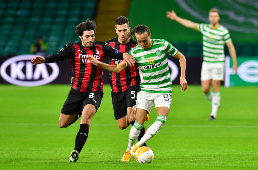 GLASGOW, SCOTLAND - OCTOBER 22: Diego Laxalt of Celtic is tackled by Sandro Tonali of AC Milan and Diogo Dalot of AC Milan during the UEFA Europa League Group H stage match between Celtic and AC Milan at Celtic Park on October 22, 2020 in Glasgow, Scotland. Sporting stadiums around the UK remain under strict restrictions due to the Coronavirus Pandemic as Government social distancing laws prohibit fans inside venues resulting in games being played behind closed doors. (Photo by Mark Runnacles/Getty Images)