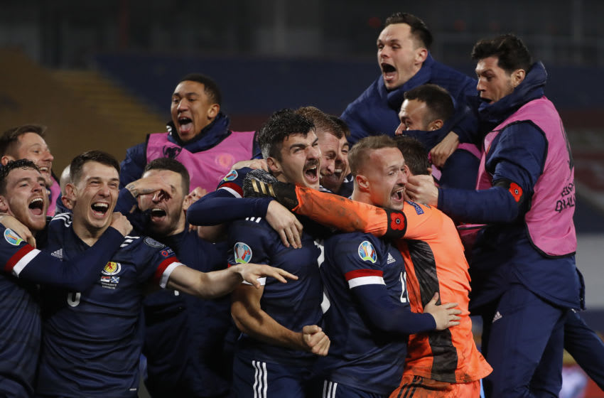 BELGRADE, SERBIA - NOVEMBER 12: David Marshall of Scotland celebrates with Leigh Griffiths of Scotland and Scott McTominay of Scotland and his team as they celebrate after their victory in the UEFA EURO 2020 Play-Off Final between Serbia and Scotland at Rajko Mitic Stadium on November 12, 2020 in Belgrade, Serbia. Football Stadiums around Europe remain empty due to the Coronavirus Pandemic as Government social distancing laws prohibit fans inside venues resulting in fixtures being played behind closed doors. (Photo by Srdjan Stevanovic/Getty Images)