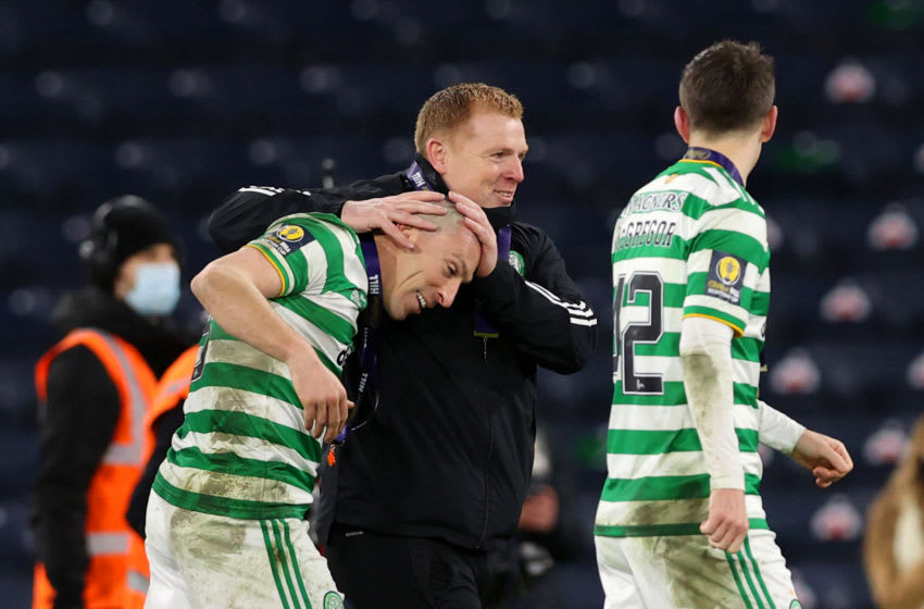 GLASGOW, SCOTLAND - DECEMBER 20: Neil Lennon, Manager of Celtic celebrates victory with Scott Brown of Celtic following a penalty shoot out in the William Hill Scottish Cup final match between Celtic and Heart of Midlothian at Hampden Park National Stadium on December 20, 2020 in Glasgow, Scotland. The match will be played without fans, behind closed doors as a Covid-19 precaution. Players of Hearts will wear the number 26 on their shorts as a tribute to Ex-Hearts player Marius Zaliukas who past away earlier in the week. (Photo by Ian MacNicol/Getty Images)