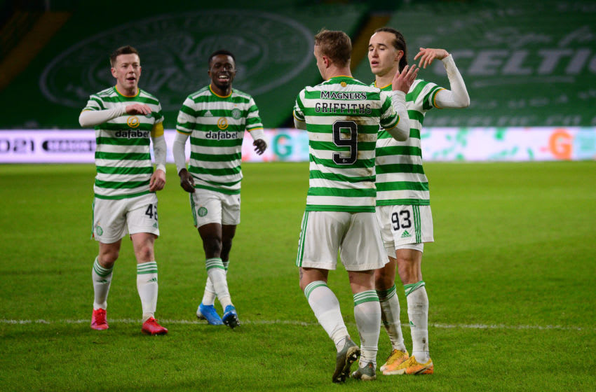 GLASGOW, SCOTLAND - DECEMBER 23: Leigh Griffiths of Celtic celebrates with teammates Diego Laxalt, Callum McGregor and Ismaila Soro after scoring their team's second goal during the Ladbrokes Scottish Premiership match between Celtic and Ross County at Celtic Park on December 23, 2020 in Glasgow, Scotland. The match will be played without fans, behind closed doors as a Covid-19 precaution. (Photo by Mark Runnacles/Getty Images)