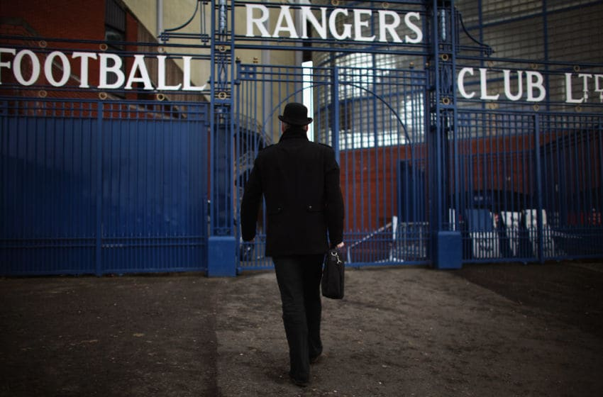 GLASGOW, SCOTLAND - FEBRUARY 17: A man dressed in a bowler hat carrying a briefcase walks towards the Ibrox Stadium gates on February 17, 2012 in Glasgow, Scotland. Rangers face Kilmarnock on Saturday following a week where the club went officially into administration, incurring a 10 point penalty from the Scottish Premier League. (Photo by Jeff J Mitchell/Getty Images)