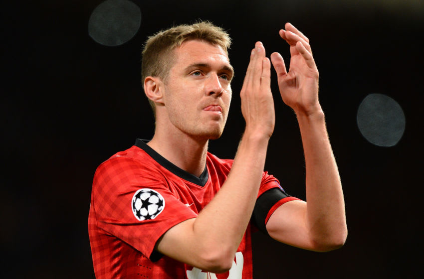 Manchester United's Scottish midfielder Darren Fletcher applauds as he leaves the field after the UEFA Champions League Group H football match between Manchester United and Galatasaray at Old Trafford in Manchester, north-west England, on September 19, 2012. AFP PHOTO/ANDREW YATES (Photo credit should read ANDREW YATES/AFP/GettyImages)