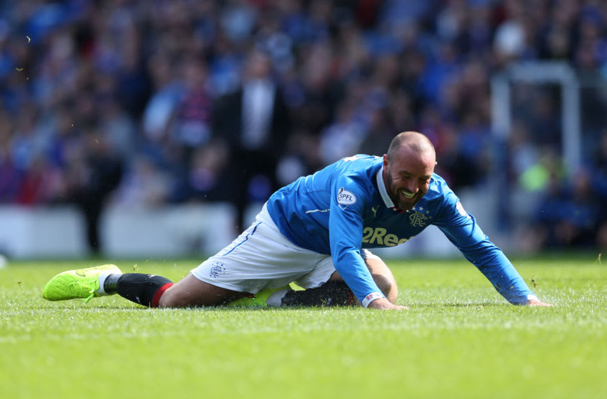 GLASGOW, SCOTLAND - AUGUST 23: Kris Boyd of Rangers falls to the ground as he chases the ball during the Scottish Championship League Match between Rangers and Dumbarton, at Ibrox Stadium on August 23, 2014 Glasgow, Scotland. (Photo by Ian MacNicol/Getty Images)