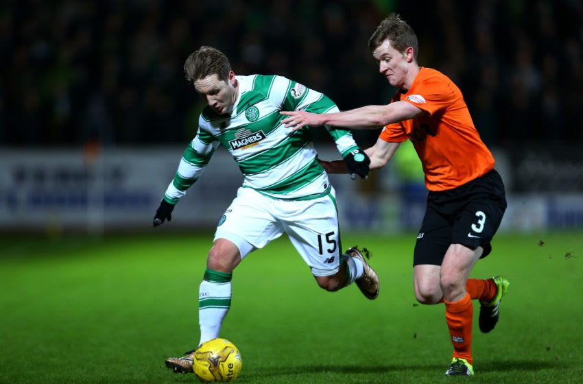 DUNDEE, SCOTLAND - JANUARY 15 : Kris Commons of Celtic is challenged by Paul Dixon of Dundee United during the Ladbrokes Scottish Premiership match between Celtic FC and Dundee United FC at Tannadice Park on January 15, 2016 in Dundee, Scotland. (Photo by Mark Runnacles/Getty Images)