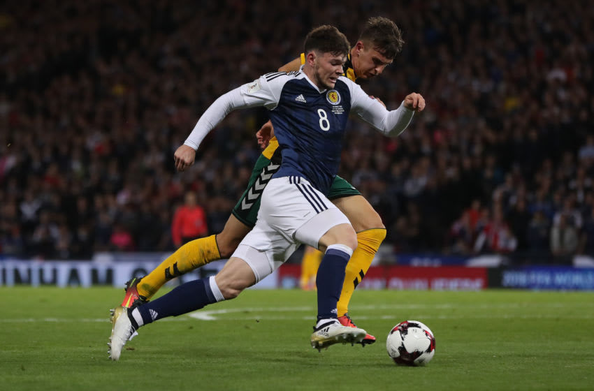GLASGOW, SCOTLAND - OCTOBER 08: Edvinas Girdvainis of Lithuania vies with Oliver Burke of Scotland during the FIFA 2018 World Cup Qualifier between Scotland and Lithuania at Hampden Park on October 8, 2016 in Glasgow, Scotland. (Photo by Ian MacNicol/Getty Images)