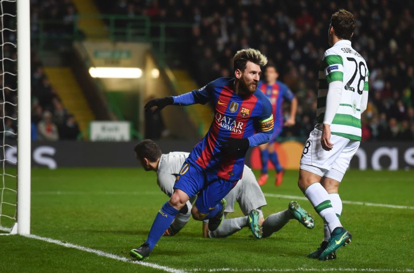 Barcelona's Argentinian striker Lionel Messi (C) celebrates scoring the opening goal during the UEFA Champions League group C football match between Celtic and Barcelona at Celtic Park in Glasgow on November 23, 2016. / AFP / Paul ELLIS (Photo credit should read PAUL ELLIS/AFP via Getty Images)