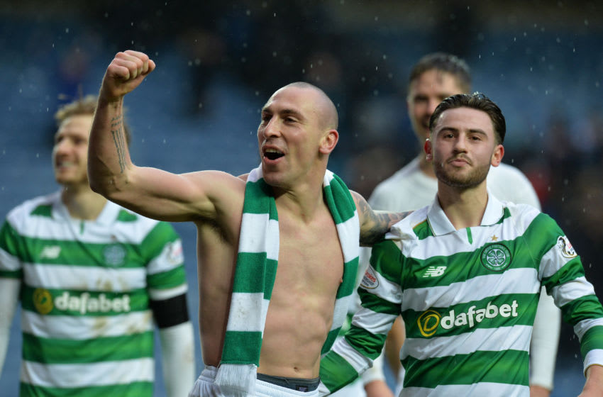 GLASGOW, SCOTLAND - DECEMBER 31: Scott Brown of Celtic celebrate at the final Whistle with team mate Patrick Roberts during the Scottish Premiership match between Rangers FC and Celtic FC at Ibrox Stadium on December 31, 2016 in Glasgow, Scotland. (Photo by Mark Runnacles/Getty Images)