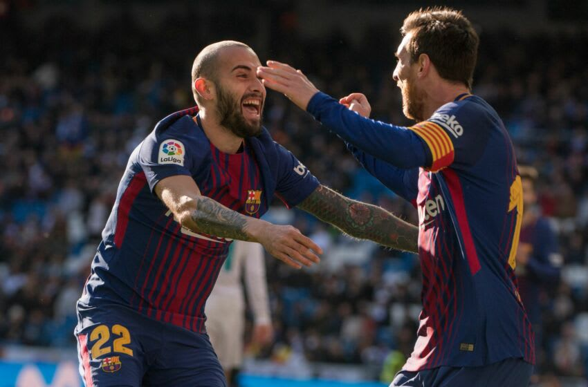 Barcelona's Spanish midfielder Aleix Vidal (L)P celebrates with Barcelona's Argentinian forward Lionel Messi after scoring during the Spanish League