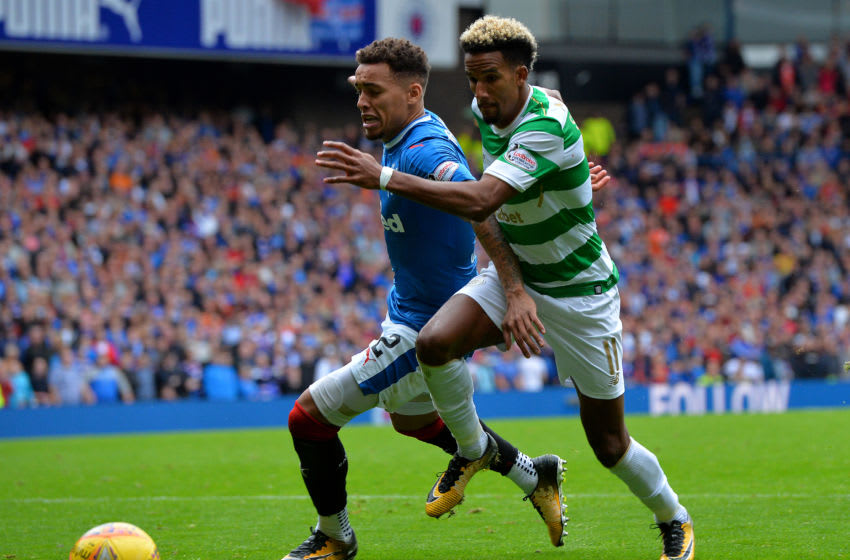 GLASGOW, SCOTLAND - SEPTEMBER 23: Scott Sinclair of Celtic is challenged by James Tavernier of Rangers during the Ladbrokes Scottish Premiership match between Rangers FC and Celtic FC at Ibrox Stadium on September 23, 2017 in Glasgow, Scotland. (Photo by Mark Runnacles/Getty Images)