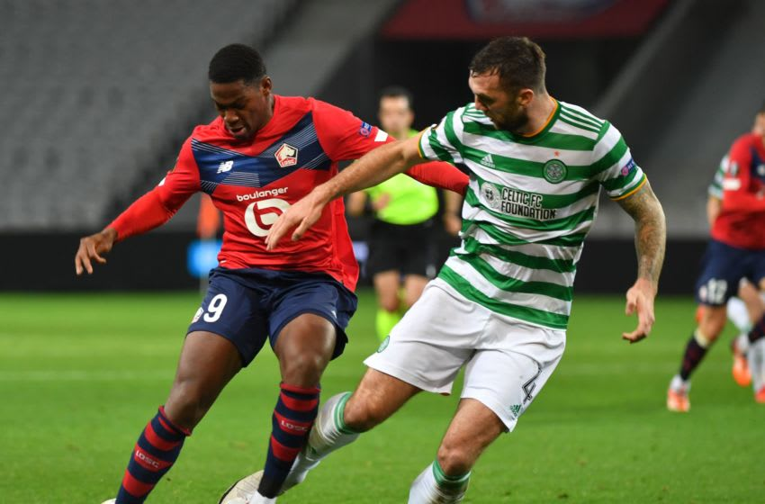 Lille's French forward Jonathan David vies for the ball with Celtic's defender Shane Duffy during the UEFA Europa League Group H football match between Lille and Celtic on October 29, 2020 at the Grand Stade Pierre-Mauroy in Lille. (Photo by DENIS CHARLET / AFP) (Photo by DENIS CHARLET/AFP via Getty Images)