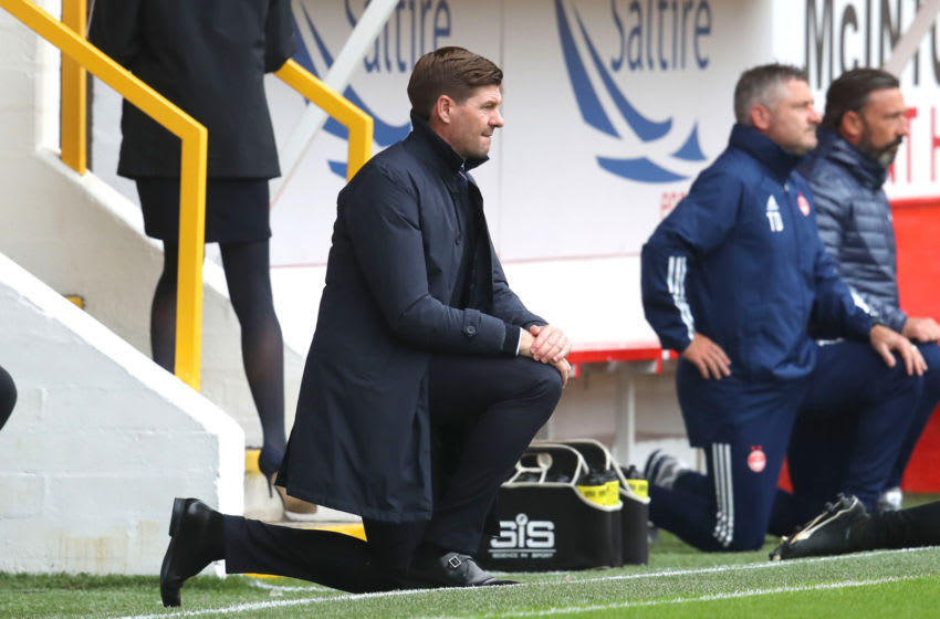 ABERDEEN, SCOTLAND - AUGUST 01: Steven Gerrard, Manager of Rangers FC takes a knee in support of the Black Lives Matter movement prior to the Ladbrokes Premiership match between Aberdeen and Rangers at Pittodrie Stadium on August 01, 2020 in Aberdeen, Scotland. Football Stadiums around Europe remain empty due to the Coronavirus Pandemic as Government social distancing laws prohibit fans inside venues resulting in all fixtures being played behind closed doors. (Photo by Andrew Milligan/Pool via Getty Images)