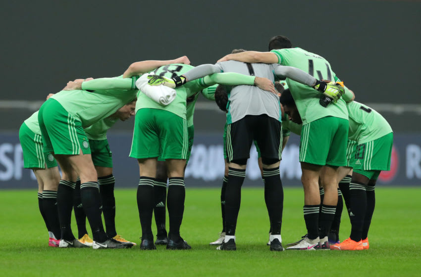MILAN, ITALY - DECEMBER 03: The Celtic team create a huddle prior to the UEFA Europa League Group H stage match between AC Milan and Celtic at San Siro Stadium on December 03, 2020 in Milan, Italy. Sporting stadiums around Italy remain under strict restrictions due to the Coronavirus Pandemic as Government social distancing laws prohibit fans inside venues resulting in games being played behind closed doors. (Photo by Emilio Andreoli/Getty Images)