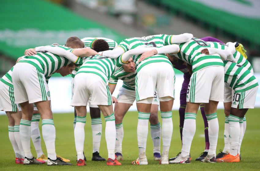 GLASGOW, SCOTLAND - DECEMBER 06: The Celtic team form a huddle ahead of the Ladbrokes Scottish Premiership match between Celtic and St. Johnstone at Celtic Park on December 06, 2020 in Glasgow, Scotland. Sporting stadiums around Scotland remain under strict restrictions due to the Coronavirus Pandemic as Government social distancing laws prohibit fans inside venues resulting in games being played behind closed doors. (Photo by Ian MacNicol/Getty Images)