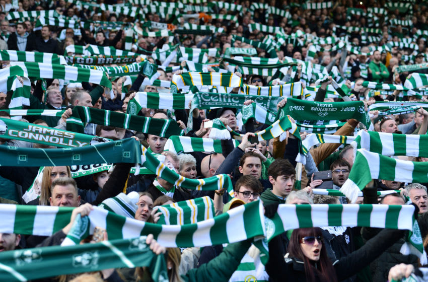 GLASGOW, SCOTLAND - MARCH 31: Celtic fans hold up scarfs ahead of the Ladbrokes Scottish Premiership match between Celtic and Rangers at Celtic Park on March 31, 2019 in Glasgow, Scotland. (Photo by Mark Runnacles/Getty Images)