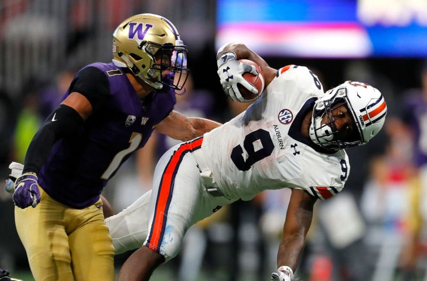 ATLANTA, GA - SEPTEMBER 01: Kam Martin #9 of the Auburn Tigers is tackled by Byron Murphy #1 as he dives over JoJo McIntosh #14 (Photo by Kevin C. Cox/Getty Images)