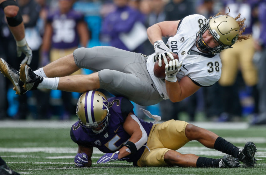SEATTLE, WA - OCTOBER 20: Defensive back Myles Bryant #5 of the Washington Huskies tackles Brady Russell #38 of the Colorado Buffaloes at Husky Stadium on October 20, 2018 in Seattle, Washington. (Photo by Otto Greule Jr/Getty Images)