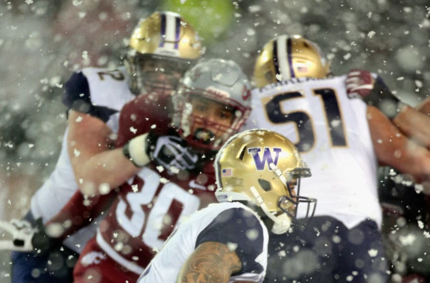 PULLMAN, WA - NOVEMBER 23: Myles Gaskin #9 of the Washington Huskies carries the ball against the Washington State Cougars in the second half at Martin Stadium during the 111th Apple Cup on November 23, 2018 in Pullman, Washington. Washington defeated Washington State 28-15. (Photo by William Mancebo/Getty Images)