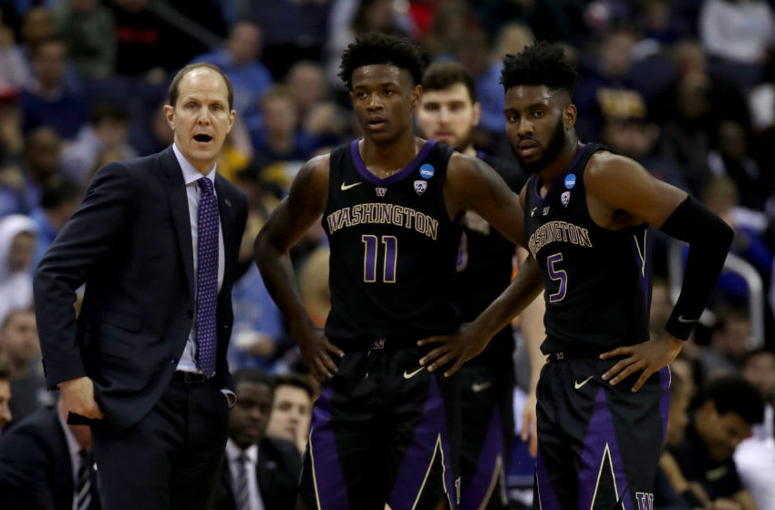 COLUMBUS, OHIO - MARCH 24: Head coach Mike Hopkins of the Washington Huskies speaks with Nahziah Carter #11 and Jaylen Nowell #5 during their game against the North Carolina Tar Heels in the Second Round of the NCAA Basketball Tournament at Nationwide Arena on March 24, 2019 in Columbus, Ohio. (Photo by Gregory Shamus/Getty Images)