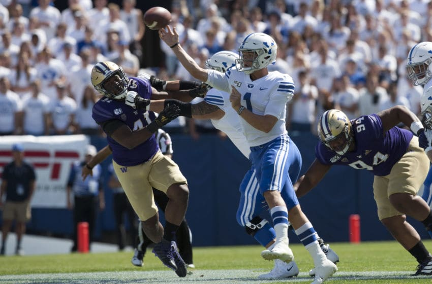 PROVO, UT - SEPTEMBER 21 : Zach Wilson #1 of the BYU Cougars is pressured by Myles Rice #41 and Sam Taimani #94 of the Washington Huskies during their game at LaVell Edwards Stadium on September 21, 2019 in Provo, Utah. (Photo by Chris Gardner/Getty Images)