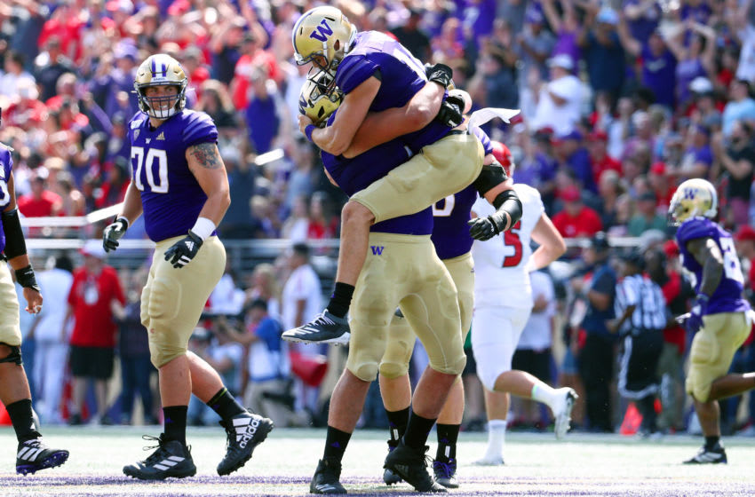SEATTLE, WASHINGTON - AUGUST 31: Jacob Eason #10 celebrates with Jaxson Kirkland #51 of the Washington Huskies after completing a 50 yard touchdown pass in the first quarter against the Eastern Washington Eagles during their game at Husky Stadium on August 31, 2019 in Seattle, Washington. (Photo by Abbie Parr/Getty Images)