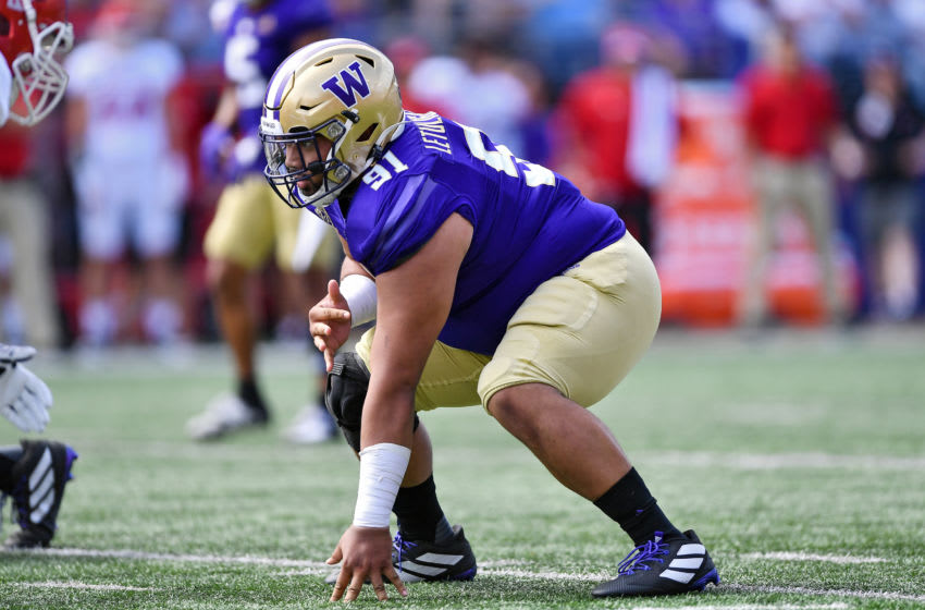 SEATTLE, WASHINGTON - AUGUST 31: Tuli Letuligasenoa #91 of the Washington Huskies sits in his stance during the first game of the season against the Eastern Washington Eagles at Husky Stadium on August 31, 2019 in Seattle, Washington. (Photo by Alika Jenner/Getty Images)