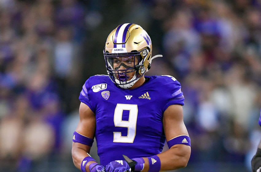 SEATTLE, WASHINGTON - SEPTEMBER 07: Joe Tryon #9 of the Washington Huskies walks to the huddle during the game against the California Golden Bears at Husky Stadium on September 07, 2019 in Seattle, Washington. (Photo by Alika Jenner/Getty Images)
