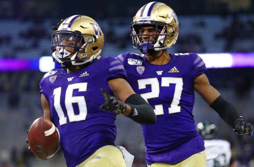 SEATTLE, WASHINGTON - SEPTEMBER 14: Cameron Williams #16 (L) celebrates with Keith Taylor #27 of the Washington Huskies after making an interception in the fourth quarter against the Hawaii Rainbow Warriors during their game at Husky Stadium on September 14, 2019 in Seattle, Washington. (Photo by Abbie Parr/Getty Images)