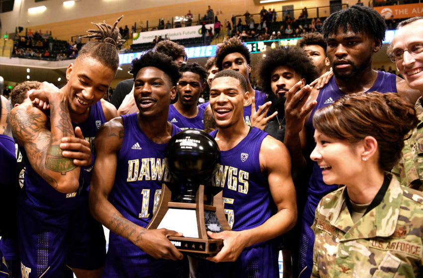 ANCHORAGE, AK - NOVEMBER 08: Elijah Hardy #10 and Quade Green #55 of the Washington Huskies celebrate with teammates following their win against the Baylor Bears during the ESPN Armed Forces Classic at Alaska Airlines Center on November 8, 2019 in Anchorage, Alaska. Washington won 67-64. (Photo by Lance King/Getty Images)
