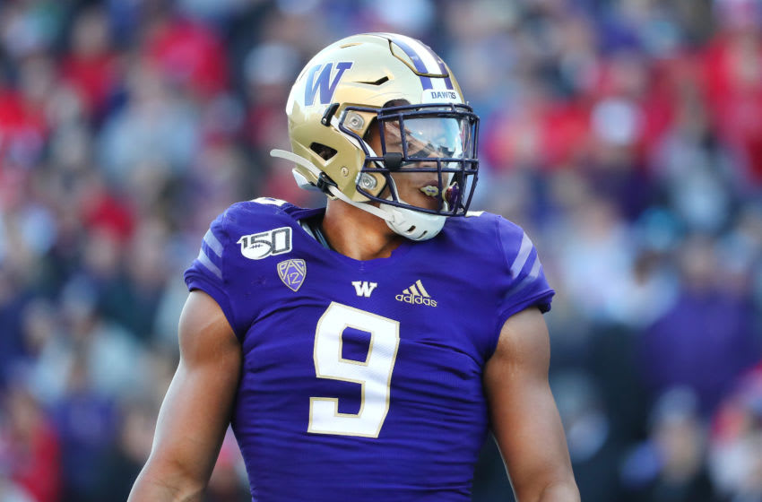 SEATTLE, WASHINGTON - NOVEMBER 02: Joe Tryon #9 of the Washington Huskies looks on in the first quarter against the Utah Utes during their game at Husky Stadium on November 02, 2019 in Seattle, Washington. (Photo by Abbie Parr/Getty Images)