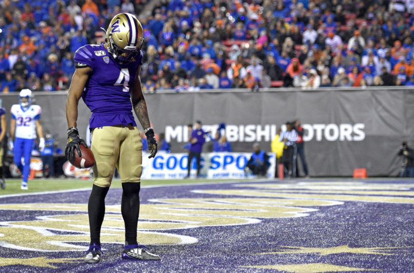 LAS VEGAS, NEVADA - DECEMBER 21: Terrell Bynum #4 of the Washington Huskies reacts after scoring a touchdown against the Boise State Broncos during the Mitsubishi Motors Las Vegas Bowl at Sam Boyd Stadium on December 21, 2019 in Las Vegas, Nevada. Washington won 38-7. (Photo by David Becker/Getty Images)