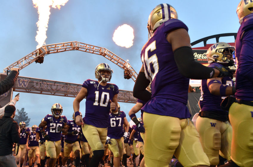LAS VEGAS, NEVADA - DECEMBER 21: Quarterback Jacob Eason #10 of the Washington Huskies runs on to the field prior to the team's game against the Boise State Broncos in the Mitsubishi Motors Las Vegas Bowl at Sam Boyd Stadium on December 21, 2019 in Las Vegas, Nevada. (Photo by David Becker/Getty Images)