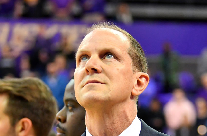SEATTLE, WASHINGTON - FEBRUARY 28: Head coach Mike Hopkins of the Washington Huskies looks at the American flag during the playing of the national anthem before the game against the Washington State Cougars at the Alaska Airlines Arena at Hec Edmundson Pavilion on February 28, 2020 in Seattle, Washington. The WSU Cougars topped the UW Huskies, 78-74. (Photo by Alika Jenner/Getty Images)