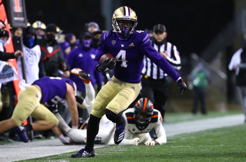 SEATTLE, WASHINGTON - NOVEMBER 14: Terrell Bynum #4 of the Washington Huskies runs with the ball in the fourth quarter against the Oregon State Beavers at Husky Stadium on November 14, 2020 in Seattle, Washington. (Photo by Abbie Parr/Getty Images)