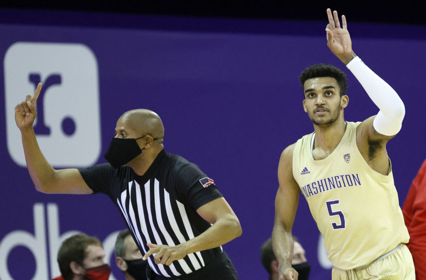 SEATTLE, WASHINGTON - JANUARY 24: Jamal Bey #5 of the Washington Huskies reacts after his three point basket against the Utah Utes during the first half at Alaska Airlines Arena on January 24, 2021 in Seattle, Washington. (Photo by Steph Chambers/Getty Images)