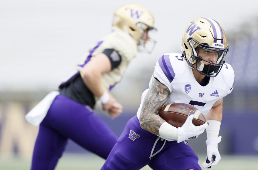 SEATTLE, WASHINGTON - MAY 01: Running back Sean McGrew #5 of the Washington Huskies warms up before the spring game at Husky Stadium on May 01, 2021 in Seattle, Washington. (Photo by Steph Chambers/Getty Images)