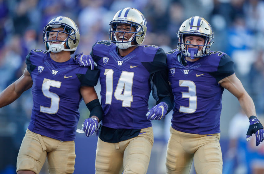 SEATTLE, WA - OCTOBER 28: Defensive back Myles Bryant #5 of the Washington Huskies celebrates with defensive back Jojo McIntosh #14 and defensive back Elijah Molden #3 after recovering a fumble against the UCLA Bruins at Husky Stadium on October 28, 2017 in Seattle, Washington. (Photo by Otto Greule Jr/Getty Images)