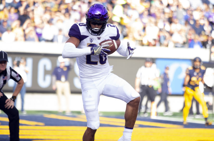 Oct 27, 2018; Berkeley, CA, USA; Washington Huskies wide receiver Ty Jones (20) gets his foot inbounds for a touchdown reception against the California Golden Bears during the first quarter of an NCAA football game at California Memorial Stadium. Mandatory Credit: D. Ross Cameron-USA TODAY Sports