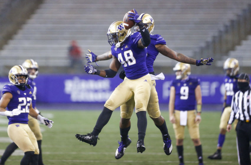 Nov 14, 2020; Seattle, Washington, USA; Washington Huskies linebacker Edefuan Ulofoshio (48) electorates after recovering a fumble against the Oregon State Beavers during the first quarter at Alaska Airlines Field at Husky Stadium. Mandatory Credit: Joe Nicholson-USA TODAY Sports