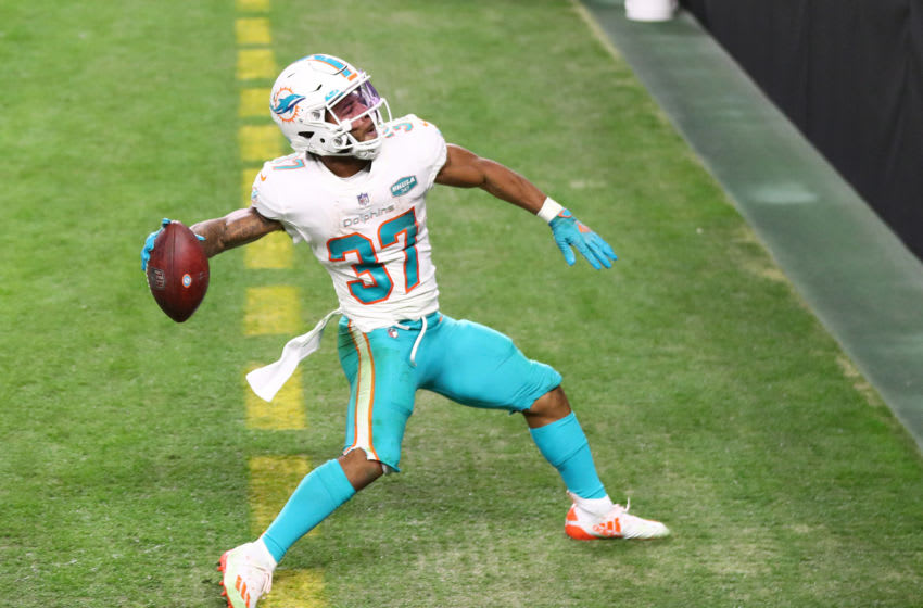 Dec 26, 2020; Paradise, Nevada, USA; Miami Dolphins running back Myles Gaskin (37) celebrates his touchdown scored against the Las Vegas Raiders/ during the second half at Allegiant Stadium. Mandatory Credit: Mark J. Rebilas-USA TODAY Sports