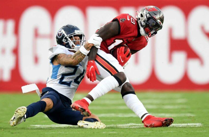 Tennessee Titans cornerback Elijah Molden (24) tackles Tampa Bay Buccaneers wide receiver Tyler Johnson (18) during the first quarter of an NFL preseason game at Raymond James Stadium Saturday, Aug. 21, 2021 in Tampa, Fla. Titans Bucs 034