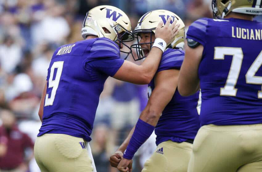 Sep 4, 2021; Seattle, Washington, USA; Washington Huskies quarterback Dylan Morris (9) celebrates with tight end Quentin Moore (88) after rushing for a touchdown against the Montana Grizzlies during the first quarter at Alaska Airlines Field at Husky Stadium. Mandatory Credit: Joe Nicholson-USA TODAY Sports