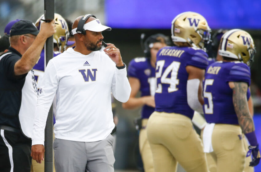 Sep 4, 2021; Seattle, Washington, USA; Washington Huskies head coach Jimmy Lake stands on the sideline during the second quarter against the Montana Grizzlies at Alaska Airlines Field at Husky Stadium. Mandatory Credit: Joe Nicholson-USA TODAY Sports