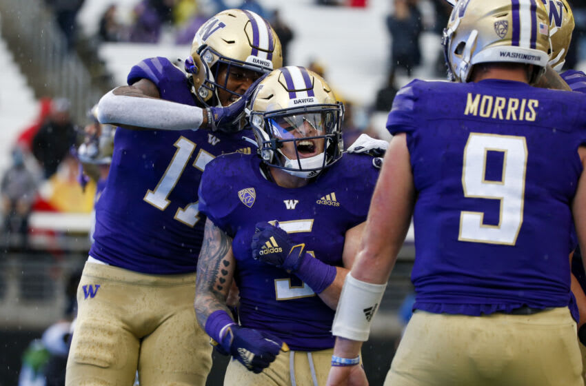 Sep 18, 2021; Seattle, Washington, USA; Washington Huskies running back Sean McGrew (5) celebrates with wide receiver Taj Davis (17) after rushing for a touchdown against the Arkansas State Red Wolves during the first quarter at Alaska Airlines Field at Husky Stadium. Mandatory Credit: Joe Nicholson-USA TODAY Sports