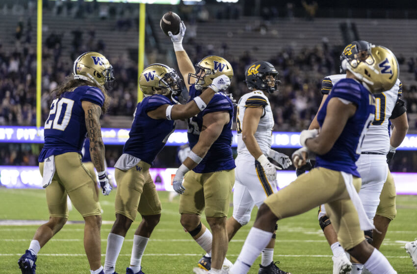 Sep 25, 2021; Seattle, Washington, USA; Washington Huskies defensive back Asa Turner (20), defensive back Kyler Gordon (2), second from left, celebrate after linebacker Ryan Bowman (55), center, recovered a California Golden Bears fumble in overtime during a game at Alaska Airlines Field at Husky Stadium. The Huskies won 31-24 in overtime. Mandatory Credit: Stephen Brashear-USA TODAY Sports