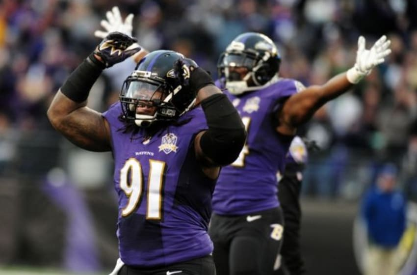 Nov 22, 2015; Baltimore, MD, USA; Baltimore Ravens linebacker Courtney Upshaw (91) celebrates in the fourth quarter against the St. Louis Rams at M&T Bank Stadium. Mandatory Credit: Evan Habeeb-USA TODAY Sports