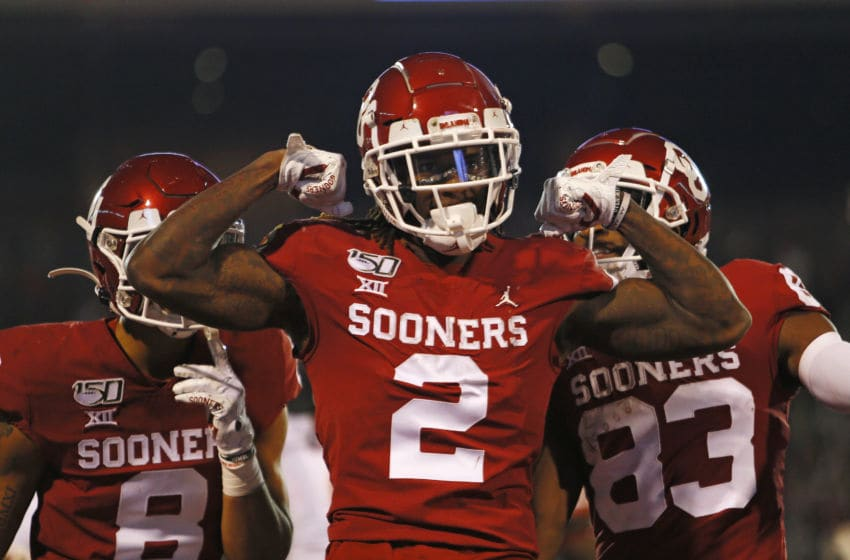 NORMAN, OK - NOVEMBER 9: Wide receiver CeeDee Lamb #2 of the Oklahoma Sooners celebrates his touchdown on a 63-yard pass and run with wide receivers Trejan Bridges #8 and Nick Basquine #83 in the game against the Iowa State Cyclones on November 9, 2019 at Gaylord Family Oklahoma Memorial Stadium in Norman, Oklahoma. The Sooners lead 35-14 at the half. (Photo by Brian Bahr/Getty Images)